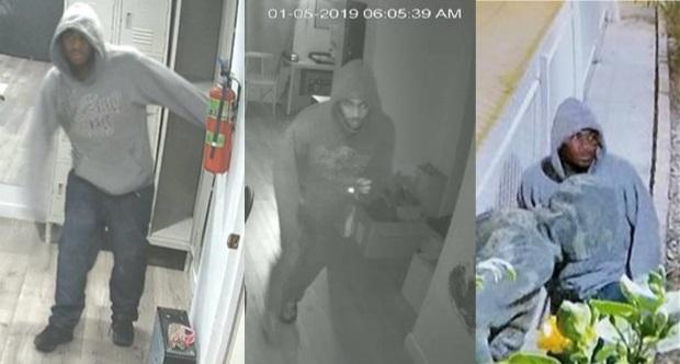 Image of third buglary suspect: African American male in grey hooded sweatshirt.