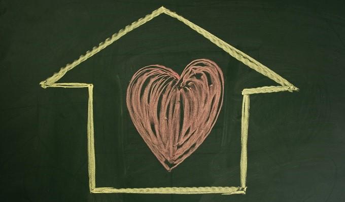 Illustration of house shape with heart shape inside