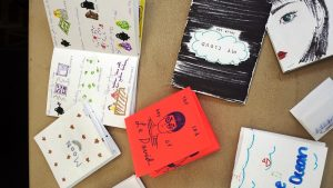 Image of various handmade zines made by teens